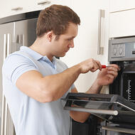 Appliance installer installing an oven-square
