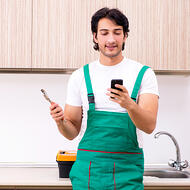 Essential plumber using Riptide on his phone to text customers-square